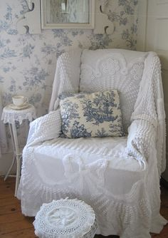 I ADORE chenille spreads!! Looks like a white chenille bedspread used as a chair cover. Nice idea!