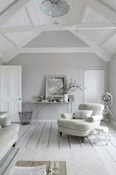 This white room looks airi and light and pure.