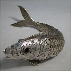 Antique Victorian Silver articulated fish with cabochon garnet eyes, c. 1890.