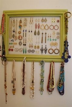 how to organize jewelry USING a frame and wire to hold earrings
