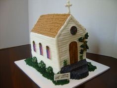 Church Homecoming Celebration - Country Church Building. Has a slight lean to the left, but I think it's part of the country charm. Cake was made for a church homecoming celebration. Lemon cake with Lemon Buttercream Frosting. Stained glass windows, doors and sign are Gumpaste. All else decorated with buttercream.