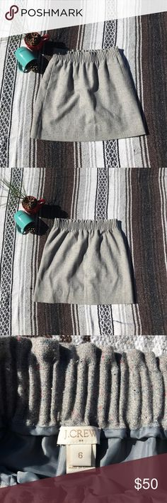J. Crew Gray Skirt NWOT J. Crew Gray Skirt 52% wool, 41% polyester, 7% other fibers. This fashionable skirt has a 100% polyester lining. This skirt is gray with tiny, tiny specks of red and blue. The skirt sits at the waist and even has a elastic waistband and pockets ladies, pockets!! Definitely a must have!  *Measurements*   Waist (across not stretched): 15 inches Length: 17 1/2 inches J. Crew Skirts