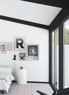 A simple Monochrome interior scheme can often create the biggest impact. We love this bedroom shot and the random hanging of pictures on the wall. Very well thought out and stylish.