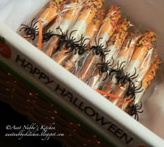 "Dipped Pretzel Rods for Halloween (I love all the Halloween designs for these! I've seen ""Eye of Newt"" and Mummies, plus ones using just regular sprinkles. Really love the idea of wrapping these up and putting a spider ring around them.)"