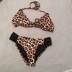 490d718b1f Sexy animal print bikini set! Top is size small. Bottoms are size XS.
