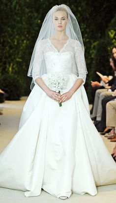 Carolina Herrera: Ivory silk faille and embroidered Chantilly lace gown