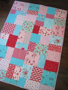 The girliest patchwork quilt!  Love the aqua, pink and red combination. by sewfunbymonique on Flickr!