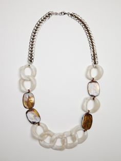 The perfect spring/summer staple necklace. Natural shell and brown accents make this the perfect neutral necklace while still making a statement!