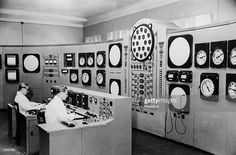 Scientists man the control desk at the Atomic Electric Station of the USSR's Academy of Sciences.