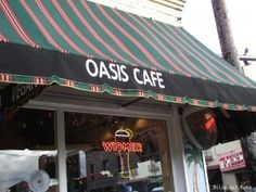 Oasis Ambience  The Oasis Café serves great pizza and really exists. You may remember it as the restaurant Chuckie and Cass pick up take-out in Raven's Wing.   Photo by Jocelyn S. Mackie, used with permission