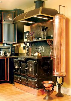 New Old Kitchen Photos, by - Old-House Journal [An nice old stove creatively updated. Luv the copper.