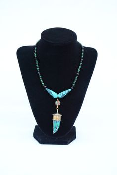 Green Tusk and Blue Turquoise Necklace. Tibetan Green Malachite Tusk Pendant. Tusk Jewelry. Green Tribal Horn Necklace. Turquoise Necklace. by flashinfashinjewelry. Explore more products on http://flashinfashinjewelry.etsy.com