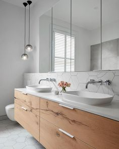 Our design team loves including a floating vanity unit within their designs to enhance the illusion of space.Have your decided if your bathroom renovation will showcase a floating or freestanding vanity unit? Laundry In Bathroom, Bathroom Inspo, White Bathroom, Bathroom Interior, Bathroom Inspiration, Small Bathroom, Master Bathroom, Bathroom Sinks, Master Baths