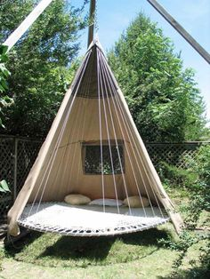 "A hanging (repurposed) ""trampoline"" tee'pee ... perfect hang-out spot in a grove of tree's! Our yard would be PERFECT for this!!"