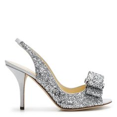 consider our newest heels a disco ball for your feet (we can't get enough of shimmer and shine). finished with a sweet bow at the toe, they're equally delightful with jeans or dressy shorts and sparkl