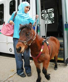 Leading the blind: Mona Ramouni has bought and trained a miniature horse, Cali, to be her guide
