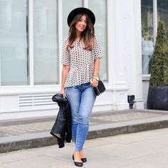 Mimi Ikonn   Polka dotted peplum shirt, jeans, black flats and hat