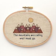 """""""The Mountains Are Calling And I Must Go"""" - John Muir (Cross Stitch by BananyaStand on Etsy)"""