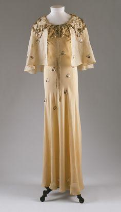 Elsa Schiaparelli | Evening ensemble, 1938.  Ivory silk organza embroidered with metallic thread, purl, and rhinestones.