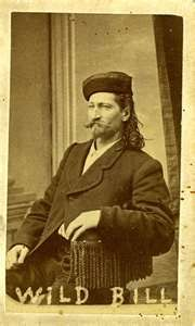 Wild Bill Hickok (5/27/1837– 8/2/1876), was a folk hero of the American Old West. His skills as a gunfighter  scout, along with his reputation as a lawman, provided the basis for his fame.    Hickok came to the West as a fugitive from justice, first working as a stagecoach driver, before he became a lawman in the frontier territories of Kansas and Nebraska. He fought for the Union Army during the American Civil War, and  after the war was a scout,  marksman.