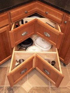 Instead of having the long dark cave of a cabinet, the corner sliding drawers make better use of your counter corners
