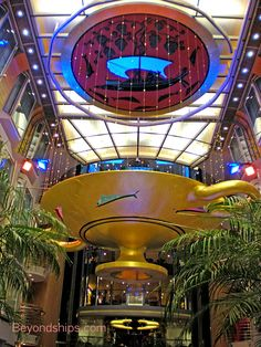 Independence of the Seas. The main attraction of the Royal Promenade is overhead – a massive ancient Greek drinking cup made of metal, glass, and gold leaf hangs from above.