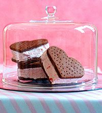 Make your own heart-shaped ice cream sandwiches by using #chocolate cookies filled with strawberry ice cream.