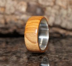 Olive wood and sterling silver ring  Wood by OliveWoodJewellery, $75.00