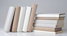 Would you cover your book collection in white paper and hand letter the titles on the spines? If we had the time, we probably would (yes, we are that fanat