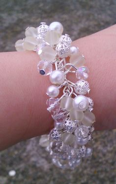 Toremore Crafts - white cluster bracelet with silver flower clasp