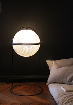 Floor or table lamp, resin tranparent, gel coat, glass fiber and weave carbon. Metallic structure and satiny polyurethane. Leather zip. Available in 3 sizes. Height: 15 inches or 29 inches and 35 inches. Width: 18 inches Source: warm white LED, Electronic variator, Electronic transformer with interchangeable power plug-in (USA, UK, UE).