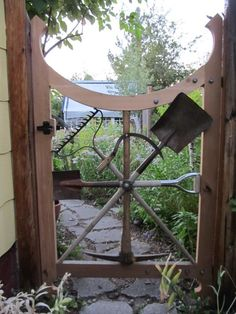 Unique Garden gate with repurposed old garden tools. Smart idea!