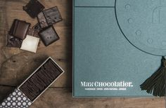 Max Chocolatier Gift Box, filled with SchoggiPlättli and CaramelPlättli. Don't go green with envy! Packaging Design Inspiration, Xmas, Christmas, Branding, Switzerland, Envy, Gifts, Box, Green