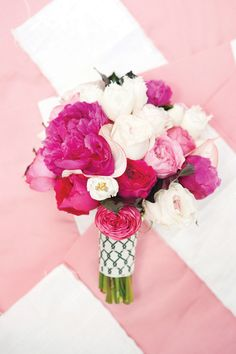We love this adorable bouquet of peonies and roses.  Photo by Perez Photography. www.wedsociety.com  #wedding #bouquet