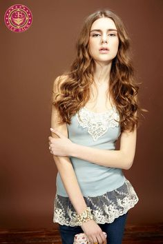 Cute tank with lace overflow on trim