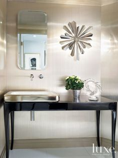 A Tony Duquette sunburst sconce, purchased from Remains Lighting in New York. Powder Room Small, Luxe Interiors, Modern Powder Rooms, Powder Room Vanity, Bathroom Inspiration, Bathroom Decor, Powder Room, Interior Design Inspiration, Sunburst Sconce