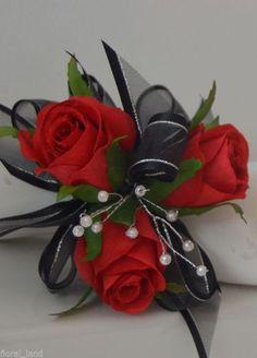 Very pretty red rose wrist corsage in diamante band, with black silver ribbons and diamante sprays. 1 x Wrist corsage. Black Corsage, Red Corsages, Prom Corsage And Boutonniere, Rose Corsage, Corsage Wedding, Boutonnieres, Wedding Cake Fresh Flowers, Silk Wedding Bouquets, Prom Flowers