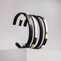 Mister roman, screw and maze cuffs. 18kt gold and all black.