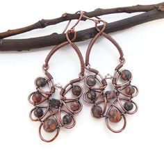 These handmade wire wrapped earrings have a chic bohemian design that is super stylish. I made them using oxidized copper wire and Leopard Jasper beads. Vintage Pink Swarovski Crystals accent the earr Wire Wrapped Earrings, Copper Earrings, Copper Jewelry, Boho Earrings, Wire Jewelry, Statement Earrings, Copper Wire, Jewellery, Handmade Rings