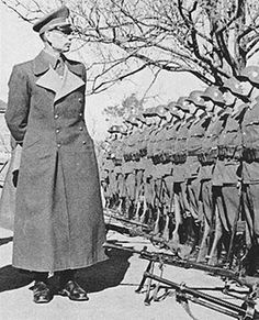General Andrei Vlasov, a former Soviet army general who, when captured by the Germans, raised an anti-Communist army from Russians, reviews his troops.