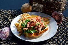 Nothing screams Cape Cod like a big, fat lobster roll. Come over to the Hearth 'n Kettle at the John Carver Inn in Plymouth, MA for your summer favorite!