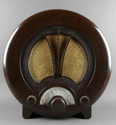 "dieselpunkflimflam: salantami: EKCO AD75 Art Deco Radio British Bakelite AM Shortwave 1938 Its ""face"" evokes that of a gas mask.."