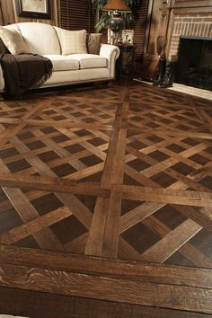 If I could afford this I would install it in my condo. White oak and leather inserts in a Versaille parquet - beautiful