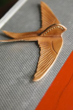 leather bird--could pin this on a leather bag!