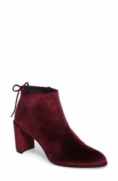 51dd08d538a9 A slim back bow provides a graceful flourish for a streamlined block-heel  bootie. by Stuart Weitzman Lofty Bootie