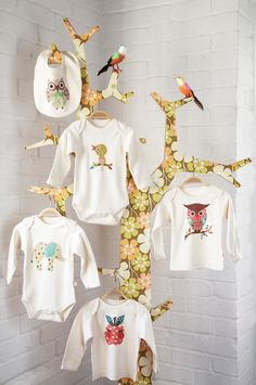 47fcc26a6 Use stands to display baby clothes for cute decorations