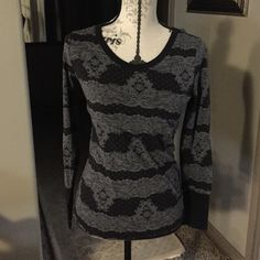 black long sleeve shirt with grey lace design. black long sleeve shirt with grey lace design. Tops Tees - Long Sleeve