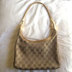 Authentic Vintage Gucci Purse Gucci purse with signature Gucci logo in tan fabric. Trimmed in tan leather. Gold accents. Scuff on side otherwise in good condition. Authentic. Purchased from Neiman Marcus. Make me an offer. Gucci Bags