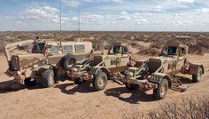 Two Husky vehicles and a Buffalo vehicle (left).