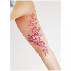Water color flower tattoo on your arm